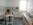 Geräumige Küche in der Pension Rückertstraße 3 in 99734 Nordhausen, Telefon 01734074163 mit Küchentisch, Stühlen, Laminatboden, Herd mit zwei Kochplatten, Spüle, Schrank mit Töpfen, Tellern, Besteck, Kaffeemaschine, Wasserkocher, Gläser, Tassen u