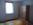 Eines der beiden Schlafzimmer der Ferienwohnung 2 in 99734 Nordhausen mit zwei von vier Betten ( die anderen beiden Betten befinden sich im zweiten Schlafzimmer ) , Kleiderschrank mit Spiegel