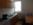 Küche der Ferienwohnung 2 in Nordhausen, Rückertstraße mit Spüle, Herd mit 2 Kochplatten, Tisch, Stühle, Schränke, Kaffeemaschine, Wasserkocher, Besteck, Teller, Tassen, Gläser, Töpfe usw